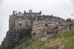 Edinburgh Castle in the Misty Rain. A typical rainy day in Edinburgh with the castle covered in mist in the background royalty free stock photo