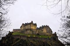 Edinburgh Castle at nightfall in winter Stock Images