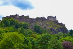 Edinburgh Castle and Princes Street Gardens in Edinburgh, Scotland royalty free stock image