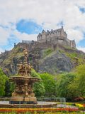 Edinburgh Castle and Ross Fountain seen from the Princes Street Gardens on a bright sunny day. stock image