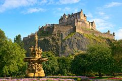 Edinburgh Castle, Scotland, Ross Fountain. Edinburgh Castle, Scotland, from Princes Street Gardens, with the Ross Fountain in the foreground Royalty Free Stock Photo
