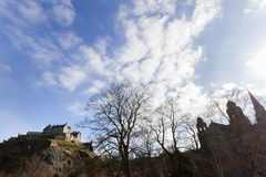 Edinburgh castle. Seen from princes street garden on a sunny day royalty free stock images
