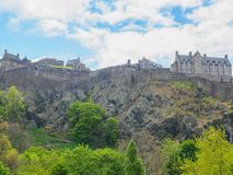 Edinburgh Castle seen from the Princes Street Gardens on a bright sunny day. stock photography