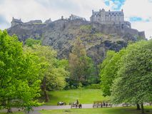 Edinburgh Castle seen from the Princes Street Gardens on a bright sunny day. stock photo
