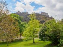 Edinburgh Castle seen from the Princes Street Gardens on a bright sunny day. Edinburgh Castle in Scotland, UK seen from the Princes Street Gardens on a bright stock photo