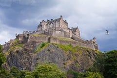 Edinburgh Castle Storm. Edinburgh Castle captured from Princes Gardens, Edinburgh, Scotland. UK. Storm rain and seagulls Royalty Free Stock Images