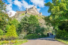 Edinburgh Castle in a summer afternoon as seen from Princes Street Gardens, Scotland. royalty free stock photography