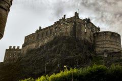 Edinburgh Castle under a moody sky. Edinburgh castle view looking skyward from foot of castle rock Stock Photography