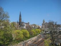 Edinburgh city center with Scott Monument and Princes Street Gardens stock photos