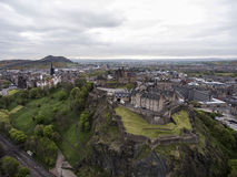 Edinburgh city historic Castle on Rock cloudy Day Aerial shot Royalty Free Stock Photo