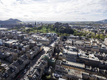 Edinburgh city historic Castle Rock sunny Day Aerial shot 3 royalty free stock image