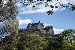 Edinburgh city historic Castle Rock sunny Day through Trees Stock Images