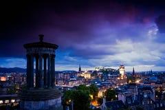 Edinburgh city night scene. Night scene of Edinburgh city with purple tone viewed from Dugald Stewart monument on Carlton Hill, Scotland Royalty Free Stock Photos