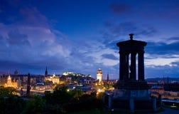 Edinburgh city night scene. Night scene of Edinburgh city with purple tone viewed from Dugald Stewart monument on Carlton Hill, Scotland Royalty Free Stock Image