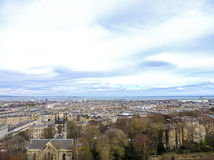 Edinburgh city panorama with Firth of Forth River in the distance. The photo was taken from Edinburgh Castle's esplanade and it shows part of the city of Royalty Free Stock Image