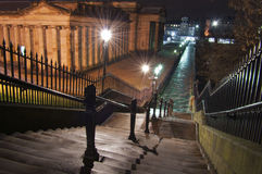 Edinburgh cityscape. Walkway in central Edinburgh at night. National museum at left Stock Image