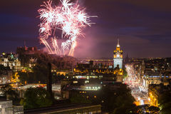Edinburgh Cityscape with fireworks. Over The Castle and Balmoral Clock Tower Stock Photos