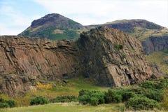 Edinburgh - dramatic rocks and Arthur`s seat Stock Photos