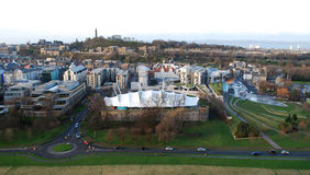 Edinburgh dynamic earth. Edinburgh view from holyrood park with dynamic earth in the centre and carlton hill in the background stock photography