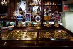 Edinburgh, Scotland - April 27, 2017 : Beer taps inside traditional english pub in Edinburgh, Scotland royalty free stock photos