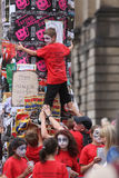 Edinburgh Fringe Festival 2013. Children grouped around a column decorated with posters for the Edinburgh Fringe 2013 Stock Images