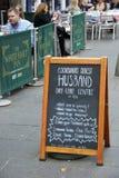 Edinburgh humour. Novel advertising hoarding outside The White Hart Inn, the oldest pub in Edinburgh, Scotland stock images