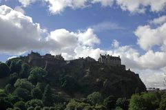 Edinburgh rock and castle, Sco. Upon a volcanic hill, Edinburgh medieval city with Castle over a cloudy Sky royalty free stock image