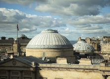 Edinburgh Rooftops. A dramatic view, just before sunset, of the rooftops of the New Town area of Edinburgh. The copper domes are part of one of the museums in royalty free stock photo