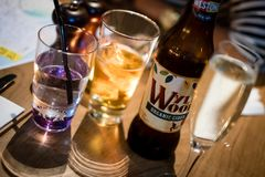 Edinburgh, Scotland - April 27, 2017: Restaurant table with alcoholic drinks, including Wyld Wood apple cider, a stock photos