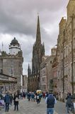 Royal Mile, touristic street of Old Town Edinburgh City in Scotland with with Tron Kirk or The Hub. Edinburgh, Scotland - April 2018: Royal Mile, touristic royalty free stock photos