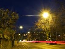 EDINBURGH, SCOTLAND-February 5, 2016-Night view of road with light and car in Edinburgh, Scotland, UK. Night view of road with light and car in Edinburgh Royalty Free Stock Images