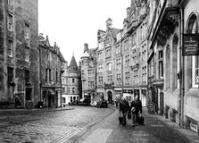 EDINBURGH, SCOTLAND-JANUARY 20: Black and white urban scene. In Edinburgh, Scotland, on January 20, 2012. In the photo we can see a street of Edinburgh with two royalty free stock photo