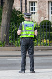 EDINBURGH, SCOTLAND - JULY 21: Police officer on guard duty near Stock Photography