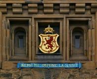 Edinburgh, Scotland - June 2nd, 2012 - Coat of arms and Scottish national motto above the main entrance of Edinburgh Castle royalty free stock photo