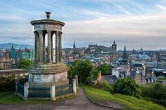 View of Edinburgh from Calton Hill with the Dugald Stewart Monument in the foreground. EDINBURGH, SCOTLAND - JUNE 18, 2016 - View of Edinburgh from Calton Hill royalty free stock image