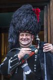 Scottish smilling bagpiper, Edinburgh, Scotland Royalty Free Stock Photo