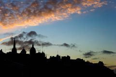 Edinburgh, Scotland, skyline silhouetted at dusk. Silhouette of the central Edinburgh Old Town skyline at dusk.  From right to left are the Castle, Royal Bank of Royalty Free Stock Photo