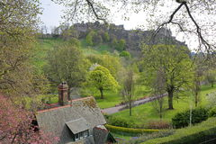EDINBURGH, SCOTLAND: Spring colors of Princes Street Gardens with a nice cottage in the foreground and the Edinburgh Castle. Spring colors of Princes Street stock images