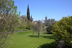 EDINBURGH, SCOTLAND: Spring colors in Princes Street Gardens with Scott Monument and Balmoral Hotel in the background. Spring colors in Princes Street royalty free stock images