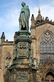 EDINBURGH, SCOTLAND : St. Giles Cathedral High Kirk of Edinburgh with Duke of Buccleuch Walter Scott Statue in the foreground Royalty Free Stock Image