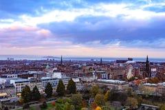 Edinburgh Scotland Sunset Panorama. Vibrant Sunset view of Edinburgh Scotland with autumn leaves Royalty Free Stock Images