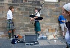 EDINBURGH, SCOTLAND, UK - AUGUST 20 2005. Bagpipe musician on Ro Royalty Free Stock Photo