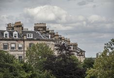 Edinburgh, Scotland, the UK - buildings and cloudy skies. This image shows a view of some old buildings in one of the streets of Edinburgh, Scotland, the UK. It royalty free stock images