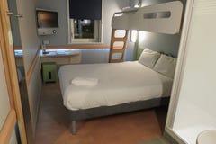 Hotel room. EDINBURGH, SCOTLAND, UK - CIRCA AUGUST 2015: Ibis budget hotel room with bed Stock Photo