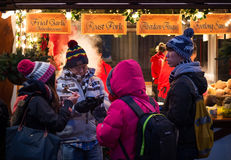 EDINBURGH, SCOTLAND, UK – December 08, 2014 - Asian tourist family enjoying fast food at Edinburgh german christmas market Stock Images