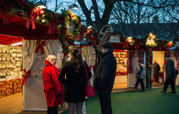 EDINBURGH, SCOTLAND, UK – December 08, 2014 - Friend talking at Edinburgh german christmas market Stock Images