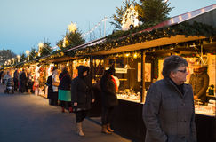 EDINBURGH, SCOTLAND, UK – December 08, 2014 - People walking among german christmas market stalls in Edinburgh, Scotland, UK Royalty Free Stock Photo