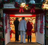 EDINBURGH, SCOTLAND, UK – December 08, 2014 - Senior citizens shopping at Edinburgh german christmas market Royalty Free Stock Image