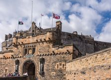 Castle gatehouse with castle towering above, Edinburgh, Scotland royalty free stock images