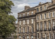 Edinburgh, Scotland, the UK - an old building. This image shows a view of an old building in one of the streets of Edinburgh, Scotland, the UK. It was taken on royalty free stock photography